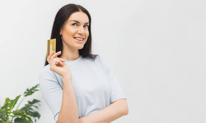 woman paying purchase credit card